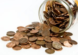 Pennies pouring out of a jar